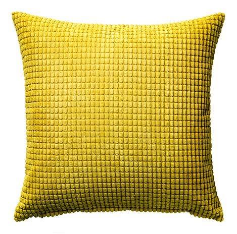 Żółta poduszka do salonu